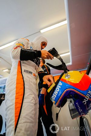 Fernando Alonso, McLaren, puts his helmet on