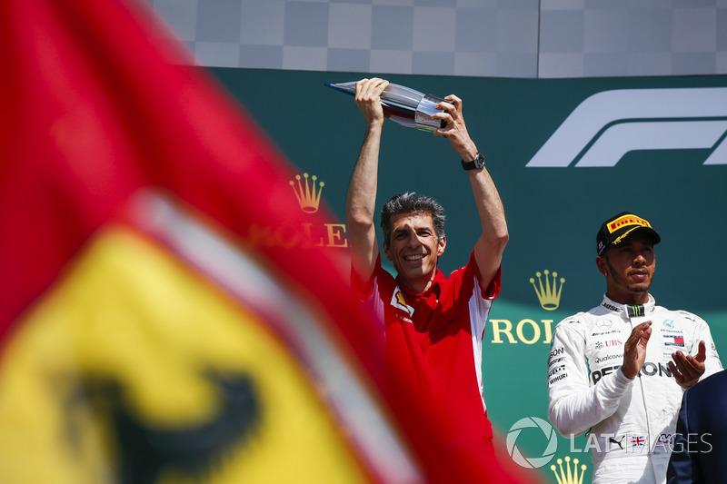 Claudio Albertini, Ferrari, receives the Constructors Trophy for Ferrari on the podium