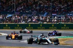 Lewis Hamilton, Mercedes AMG F1 W09, leads Fernando Alonso, McLaren MCL33, Pierre Gasly, Toro Rosso STR13, and Romain Grosjean, Haas F1 Team VF-18
