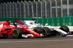 Sebastian Vettel, Ferrari SF70H, battles Felipe Massa, Williams FW40