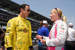 Helio Castroneves, Team Penske Chevrolet talking with Pippa Mann, Dale Coyne Racing Honda