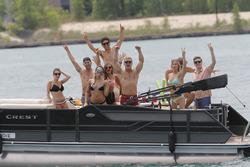 Fans en un bote