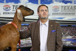 Texas Motor Speedway president Eddie Gossage with Lil Dale, a stuffed goat