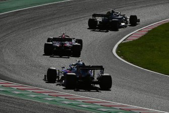 Romain Grosjean, Haas F1 Team VF-19, leads Kimi Raikkonen, Alfa Romeo Racing C38, and Daniil Kvyat, Toro Rosso STR14