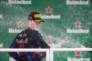 Pierre Gasly, Toro Rosso, 2nd position, is sprayed with Champagne on the podium