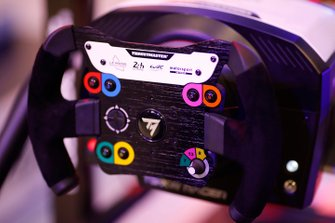 The steering wheel in the simulator on the Le Mans eSports Series stand