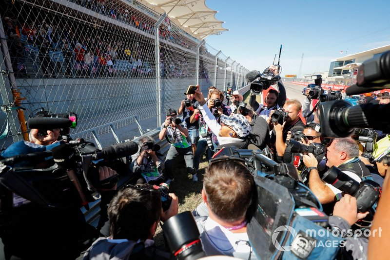 Lewis Hamilton, Mercedes AMG F1, is surrounded by photographers at the drivers parade