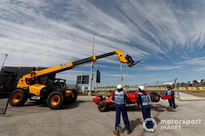Marshals remove the car of Charles Leclerc, Ferrari SF90