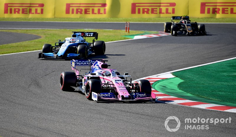 Sergio Perez, Racing Point RP19, leads George Russell, Williams Racing FW42, and Kevin Magnussen, Haas F1 Team VF-19