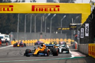 Carlos Sainz Jr., McLaren MCL34, leads Lewis Hamilton, Mercedes AMG F1 W10