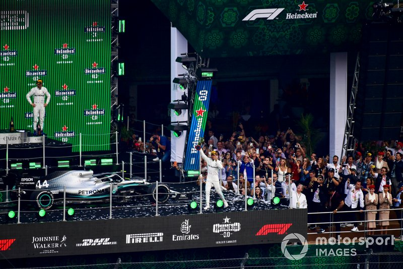 Lewis Hamilton, Mercedes AMG F1, 1st position, celebrates with his trophy on the podium
