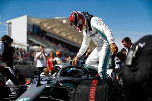 Lewis Hamilton, Mercedes AMG F1, climbs out of his car on the grid