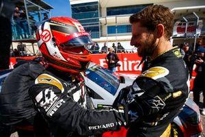 Romain Grosjean, Haas F1 Team Team, and Kevin Magnussen, Haas F1 Team Team, ride with Tony Stewart