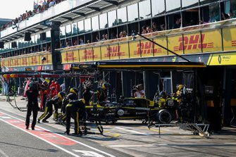 Daniel Ricciardo, Renault F1 Team R.S.19, is pushed into the garage as he retires from the race