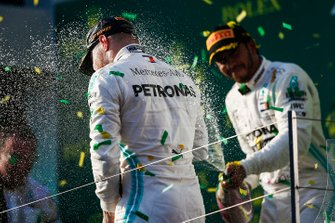 Lewis Hamilton, Mercedes AMG F1, 2nd position, blasts Valtteri Bottas, Mercedes AMG F1, 1st position, with Champagne on the podium