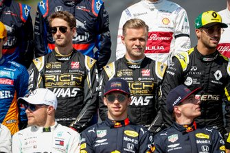 Romain Grosjean, Haas F1, Kevin Magnussen, Haas F1, and Daniel Ricciardo, Renault F1 Team stand behind Valtteri Bottas, Mercedes AMG F1, Pierre Gasly, Red Bull Racing, and Max Verstappen, Red Bull Racing