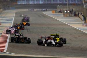 Kimi Raikkonen, Alfa Romeo Racing C38, leads Nico Hulkenberg, Renault R.S. 19, and Kevin Magnussen, Haas F1 Team VF-19