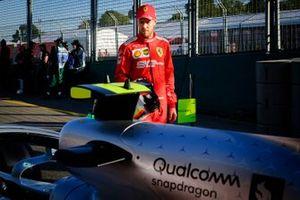 Sebastian Vettel, Ferrari looks on the Mercedes AMG F1 W10