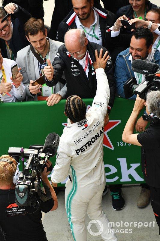 Lewis Hamilton, Mercedes AMG F1, 1st position, celebrates with Dr Dieter Zetsche, CEO, Mercedes Benz, in Parc Ferme