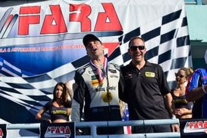 Cristian Fitipaldi dances in victory lane with Eric Curran