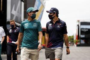Sebastian Vettel, Aston Martin and Sergio Perez, Red Bull Racing in the paddock