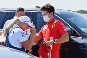 Charles Leclerc, Ferrari, signs an autograph for a fan
