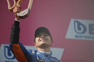Lando Norris, McLaren , 3rd position, on the podium with his trophy