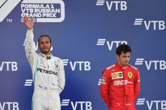 Lewis Hamilton, Mercedes AMG F1, 1st position, and Charles Leclerc, Ferrari, 3rd position, on the podium