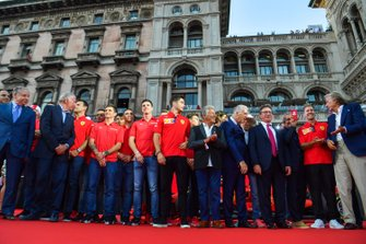 Charles Leclerc, Ferrari, Mario Andretti, and Piero Lardi Ferrari stand amongst the Ferrari Academy drivers and former Ferrari F1 drivers and team personnel
