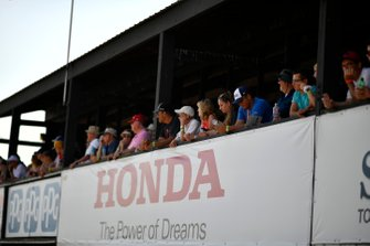 Race fans watch pit lane, atmosphere
