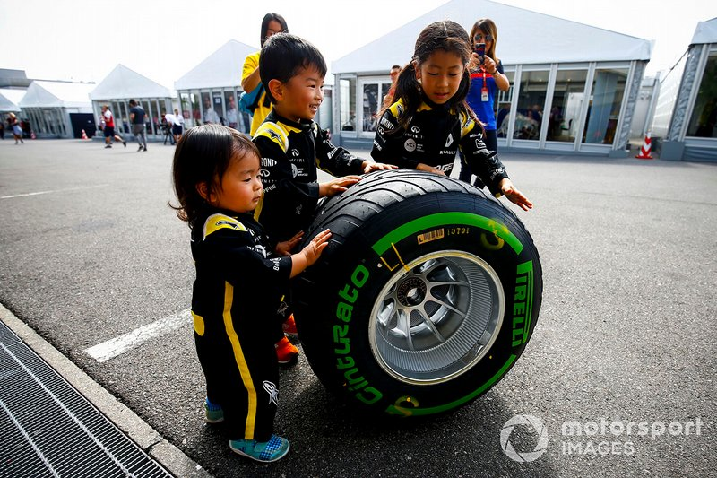 Young fans with Pirelli tyre