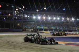 Lewis Hamilton, Mercedes AMG F1 W10 and Kevin Magnussen, Haas F1 Team VF-19