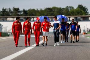 Charles Leclerc, Ferrari walks the track with his brother Arthur Leclerc and his mechanics