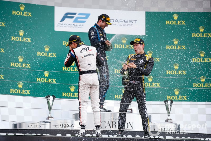 Race winner Nicholas Latifi, Dams celebrates on the podium with the champagne and Nyck De Vries, ART Grand Prix and Jack Aitken, Campos Racing