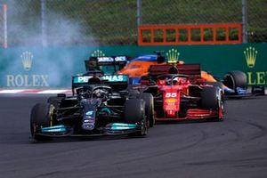 Lewis Hamilton, Mercedes W12, passes Carlos Sainz Jr., Ferrari SF21