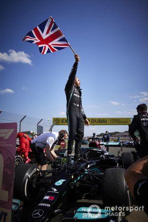Lewis Hamilton, Mercedes, 1st position, celebrates in Parc Ferme with a Union flag