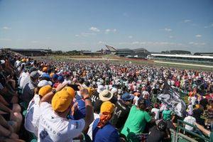 Sergio Perez, Red Bull Racing RB16B, Nicholas Latifi, Williams FW43B, and Nikita Mazepin, Haas VF-21, chase the pack