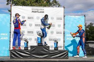 Alex Palou, Chip Ganassi Racing Honda, Alexander Rossi, Andretti Autosport Honda, Scott Dixon, Chip Ganassi Racing Honda celebrate on the podium with champagne