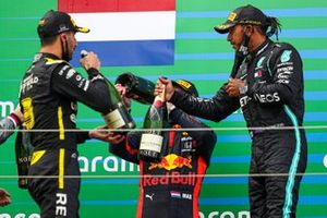 Lewis Hamilton, Mercedes-AMG F1, 1st position, Max Verstappen, Red Bull Racing, 2nd position, and Daniel Ricciardo, Renault F1, 3rd position, celebrate on the podium with champagne