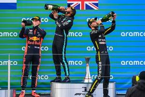 Max Verstappen, Red Bull Racing, 2nd position, Lewis Hamilton, Mercedes-AMG F1, 1st position, and Daniel Ricciardo, Renault F1, 3rd position, drink Champagne on the podium