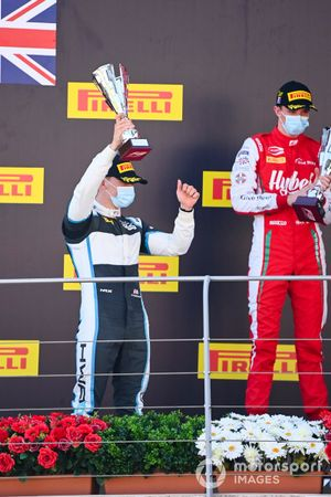 Jake Hughes, HWA Racelab, Race Winner Frederik Vesti, Prema Racing celebrate on the podium with the trophy