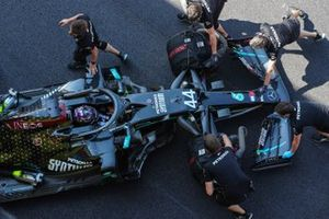 Lewis Hamilton, Mercedes F1 W11 is pushed back into the garage