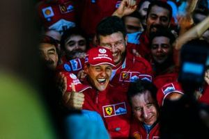 Michael Schumacher celebrates victory in both the race and the world championship with Ross Brawn, Technical Director, Ferrari, Jean Todt, Team Principal, Ferrari, and the rest of the Ferrari team