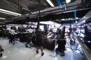 Mechanics work on the cars in the garage