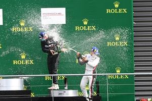 Florian Latorre, CLRT, 3rd position, and Ayhancan Guven, martinet by Almeras, 1st position, battle with Champagne on the podium