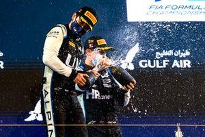 Guanyu Zhou, Uni-Virtuosi Racing, 2nd position, and Oscar Piastri, Prema Racing, 1st position, celebrate on the podium
