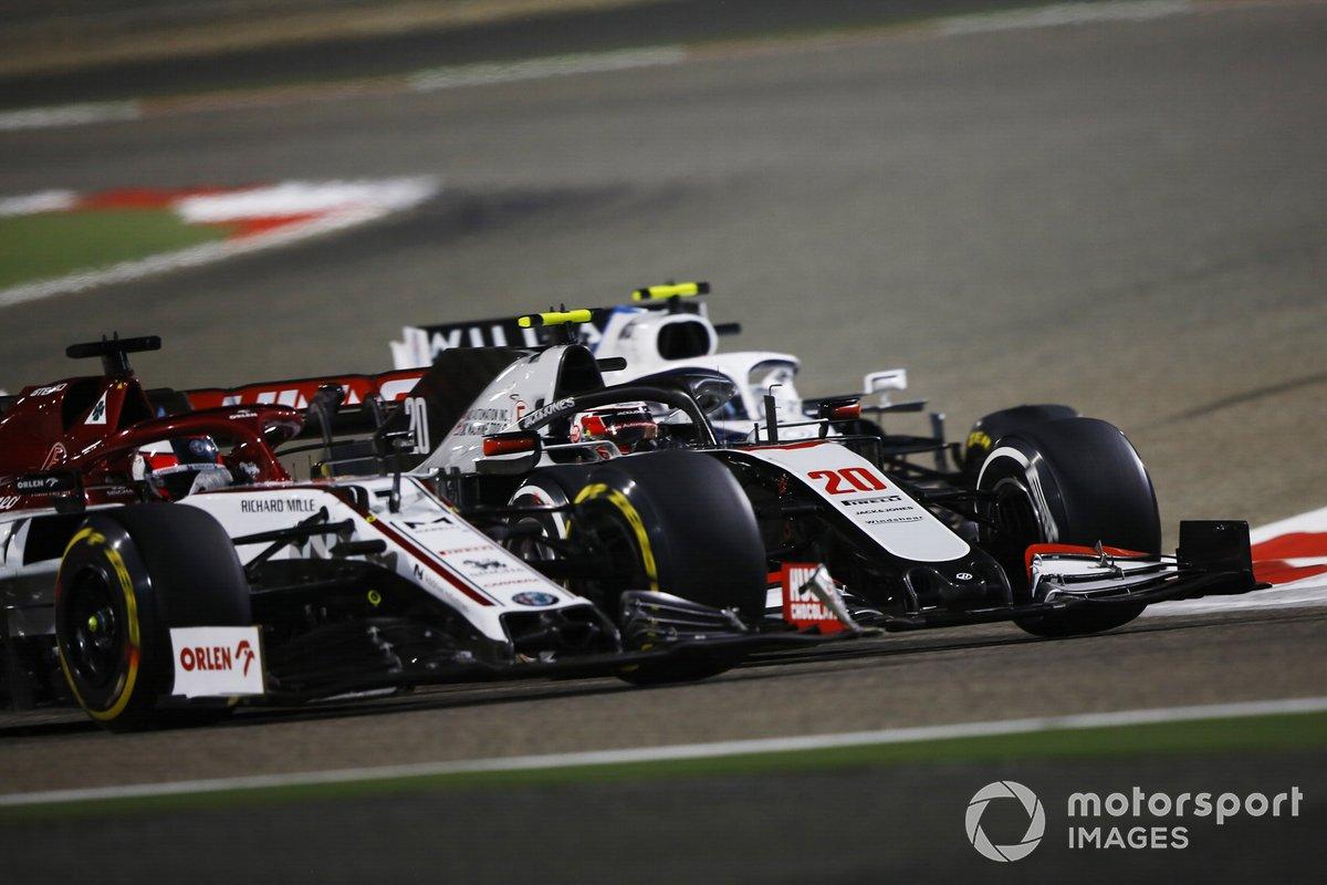 Nicholas Latifi, Williams FW43, battles Kevin Magnussen, Haas VF-20, Kimi Raikkonen, Alfa Romeo Racing C39