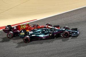 Lance Stroll, Aston Martin AMR21, passes Carlos Sainz Jr., Ferrari SF21
