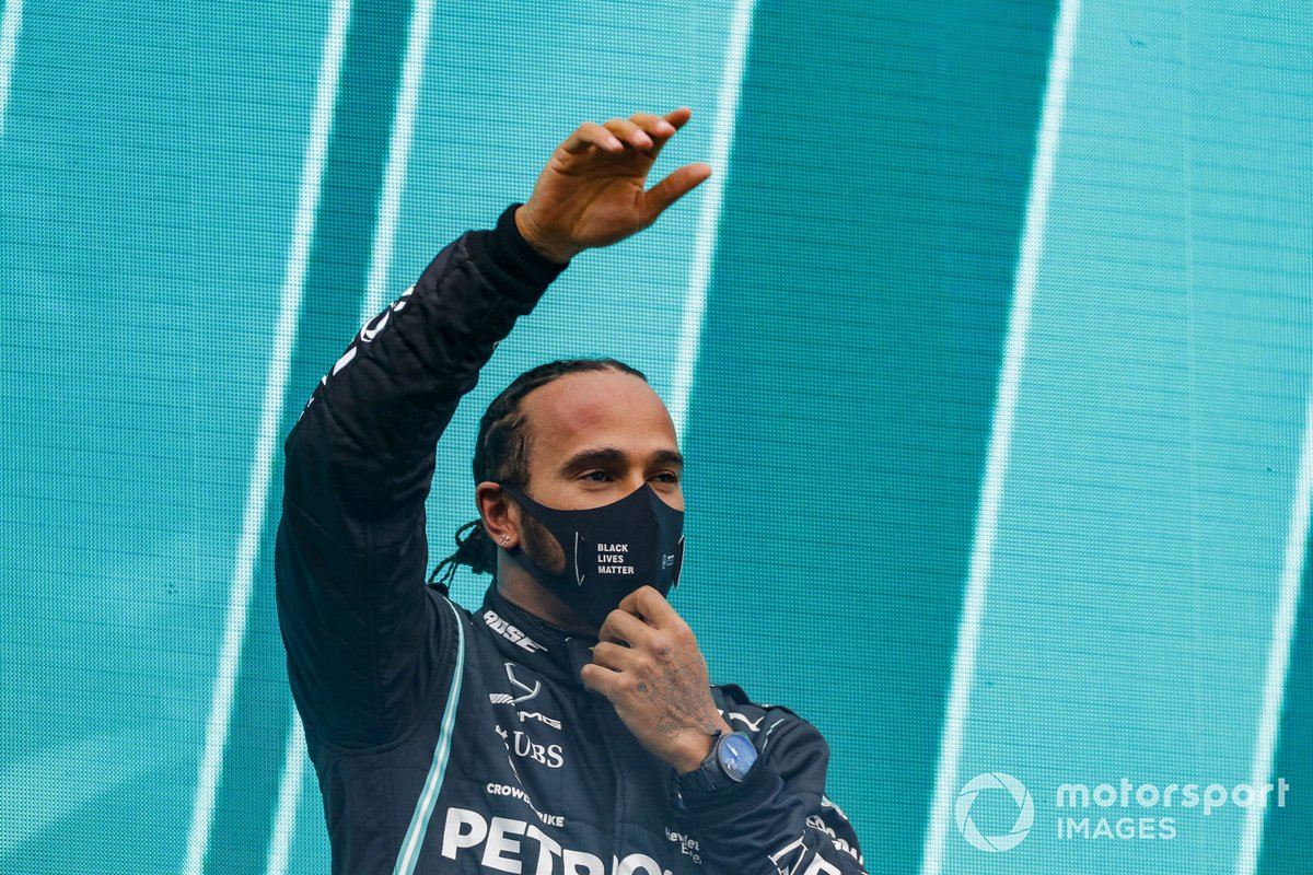 Lewis Hamilton, Mercedes-AMG F1, waves on the podium after winning the race, to take his 7th World Championship title