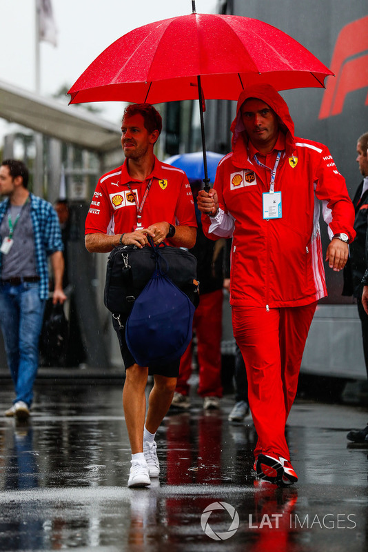 Sebastian Vettel, Ferrari, arrives in the paddock